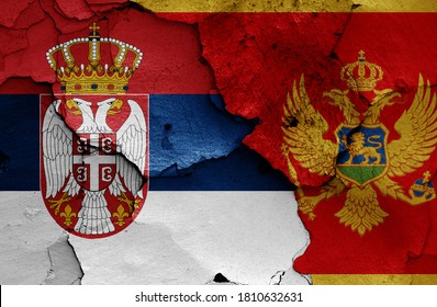 flags of Serbia and Montenegro painted on cracked wall