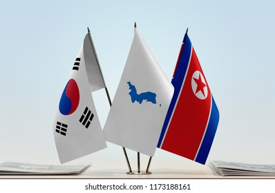 Flags of South Korea and North Korea with a Korean Unification flag in the middle. Cloth of flags is 3d rendering, the rest is a photo.