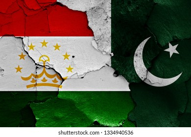 flags of Tajikistan and Pakistan painted on cracked wall