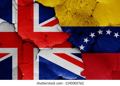 flags of UK and Venezuela painted on cracked wall