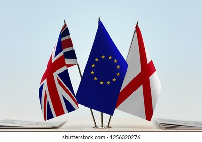 Flags of United Kingdom European Union and Northern Ireland (Saint Patrick's Saltire). Brexit concept. Cloth of flags is 3d rendering, the rest is a photo.