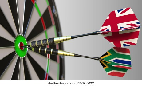 Flags of the United Kingdom and South Africa on darts hitting bullseye of the target. International cooperation or competition conceptual 3D rendering