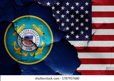 flags of United States Coast Guard and USA painted on cracked wall