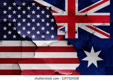 flags of USA and Australia painted on cracked wall