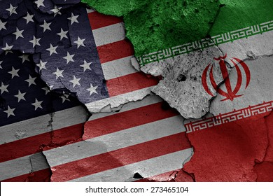 flags of USA and Iran painted on cracked wall