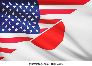 Flags of USA and Japan blowing in the wind. Part of a series.