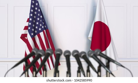 Flags of the USA and Japan at international meeting or conference. 3D rendering