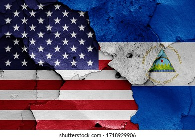 flags of USA and Nicaragua painted on cracked wall