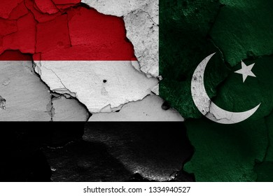 flags of Yemen and Pakistan painted on cracked wall