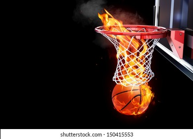 Flaming basketball going through a court net. Room for text or copy space on a black background.