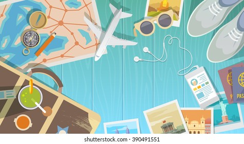 Flat web banner on the theme of travel , vacation, adventure. Preparing for your journey. Outfit of modern traveler. Objects on wooden background. Top view. Discover a new world.
