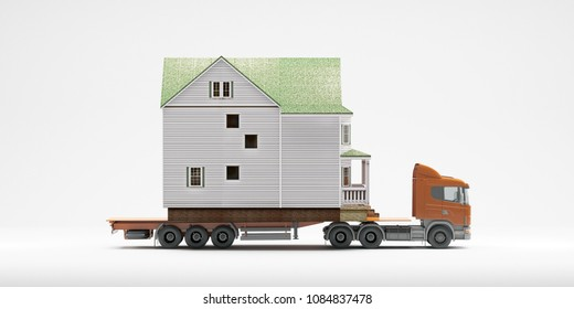 A flatbed articulated lorry loaded with a house isolated on a white background. Both are models. Good image for moving home themes.