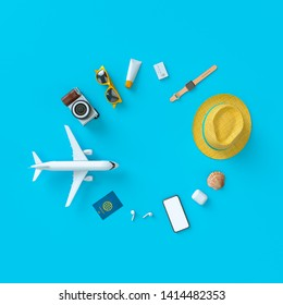 Flatlay with toy plane with sun glasses, slippers, hat, suntan cream, phone and camera on blue minimal style background. Travel concept. 3D model render visualization illustration