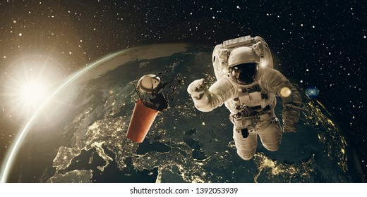 Floating astronaut and coffee mug at sunrise. Coffee break and breakfast concept. 3D and photo illustration with analog film look, elements from NASA.
