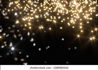 Floating specks of light on black background, 3d rendering. Computer digital drawing.