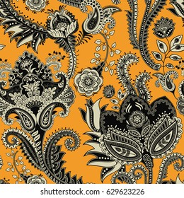 Floral seamless pattern. Yellow indian decorative wallpaper. Batik indonesia. Colorful pattern with paisley and stylized flowers. Design for wrapping paper, cover, fabric, textile, wallpaper, curtains