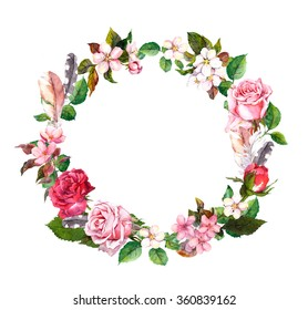 Floral wreath with apple or cherry flowers (sakura blossom), roses flowers and feathers. Watercolor round border