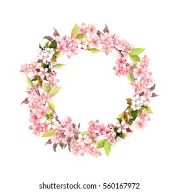 Floral wreath - branches of apple blossom, cherry tree flowers (sakura). Watercolor