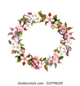 Floral wreath with spring flowers and keys. Watercolor round border