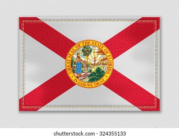 Florida flag leather label on a white leather background,vintage style