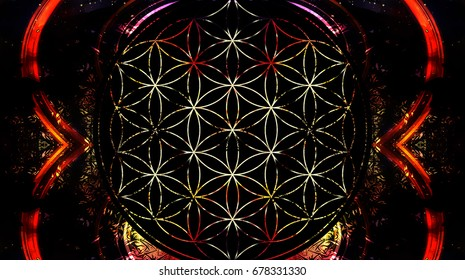 Flower of life on black background and light effect. Sacred geometry.