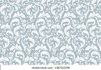 Flower pattern. Seamless white and blue ornament. Graphic background. Ornament for fabric, wallpaper, packaging