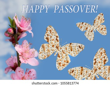 flowering peach and butterflies made from matzo on the background of bright blue sky with the inscription - Happy Passover
