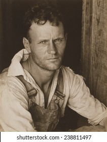 Floyd Burroughs, sharecropper. Hale County, Alabama. Published in the book, 'Let Us Now Praise Famous Men'. photograph by Walker Evans, July, 1936.