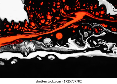 Fluid art texture. Backdrop with abstract swirling paint effect. Liquid acrylic artwork that flows and splashes. Mixed paints for interior poster. Orange, black and white overflowing colors.
