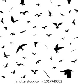 Flying birds silhouettes on white background. Animals seamless detailed pattern. Black on white backgound