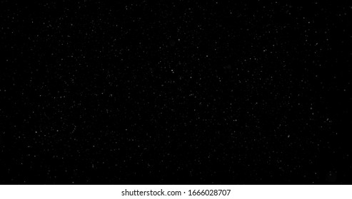 Flying dust particles on a black background