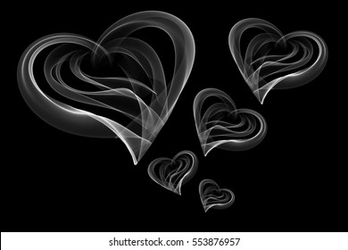 flying hearts written with fire flame or smoke on black background.