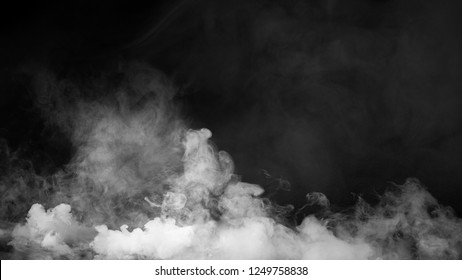 Fog and mist effect on isolated black background for text or space