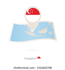 Folded paper map of Singapore with flag pin of Singapore. Raster copy.