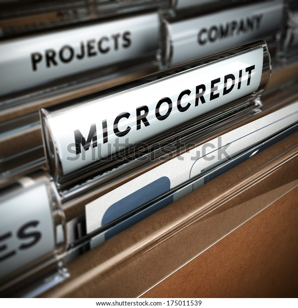 Folder with focus on a tab and the word microcredit, blur effect. Concept of company projects funding.