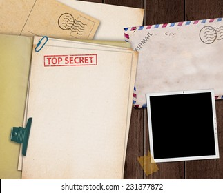 folder with TOP SECRET stamped across the front page and a blank photograph