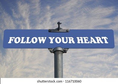 Follow your heart road sign