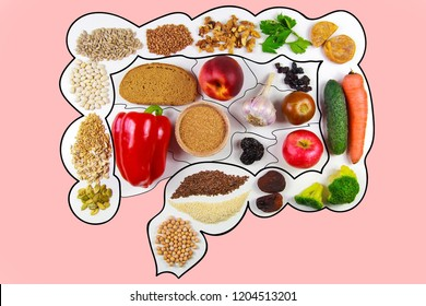 Food for bowel Health. Kefir, Bifidobacteria, greens, apples, fiber, dried fruits, nuts, pepper, whole bread, cereals, broccoli, chickpeas, flax seed. Isolate on a pink background