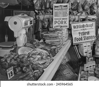 Food Market display welcoming Food Stamps made available to Americans on relief from 1939 to 1943. The first Food Stamp program was initiated by Sec. of Agriculture Henry Wallace.
