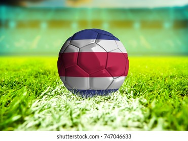 football ball with the national flag of Costa Rica ball with Green grass background