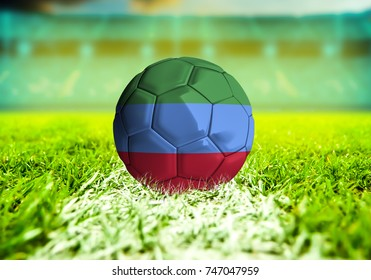 football ball with the national flag of Dagestan ball with Green grass background