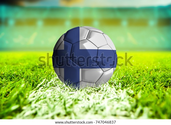 football ball with the national flag of Finland ball with Green grass background