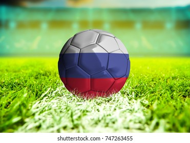 football ball with the national flag of Russia ball with Green grass background