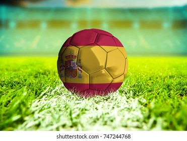 football ball with the national flag of Spain ball with Green grass background