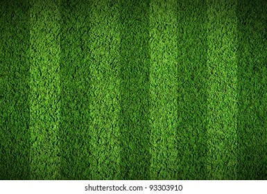 Football lined green grass