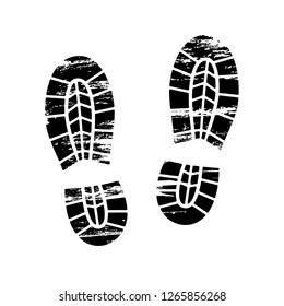 Footprints and shoeprints icon in black and white showing bare feet and the imprint of the soles with patterns of male and female footwear. Shoes boots imprint