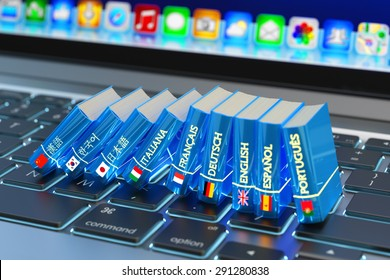 Foreign languages learn and translate education concept, books with flags of world countries on computer laptop keyboard