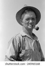 Former oil worker working in a ditch-digging gang. Before the Great Depression he was a skilled oil driller and pipeline builder in the Oklahoma oil fields. August 1939.