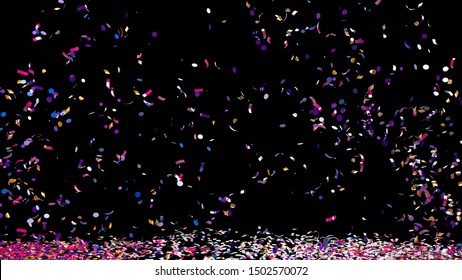 A fountain of colorful confetti falling on the floor on an black background