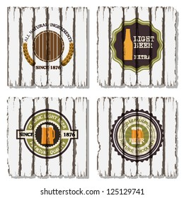 Four beer labels on old wood background. Raster version